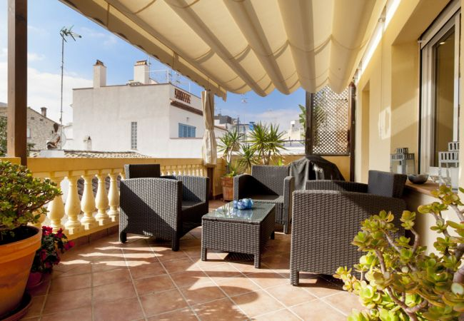 Relax in the shaded area with a nice glass of cava.